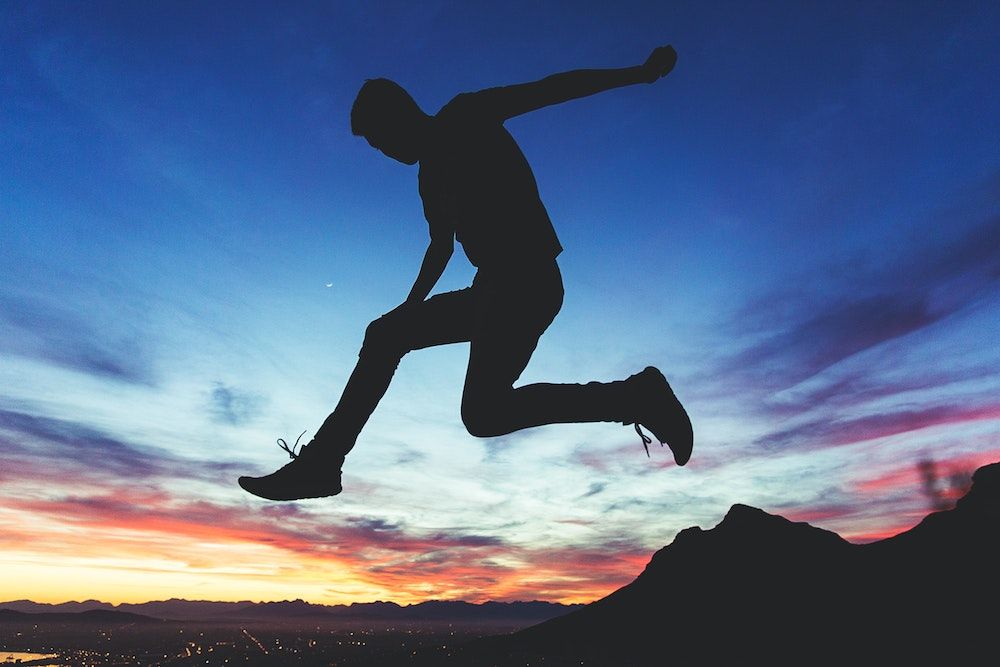 Blog header image showing a man leaping for the Make the Leap to eCommerce Success with this eBook from Acumatica eCommerce experts blog post from Dynamic Tech Services